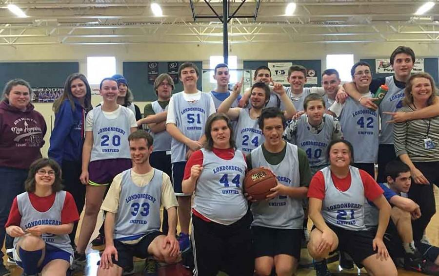 Unified+basketball+celebrates+after+beating+Nashua+South+58-54+during+their+2016+season.+This+game+solidified+their+undefeated+season.