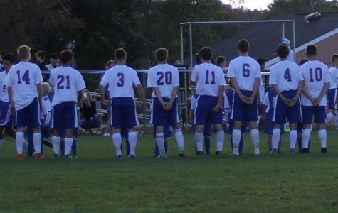 The boys' soccer team line sup before one of their games. The team will need to bring a similar game  plan against Memorial that made them successful last week against them.