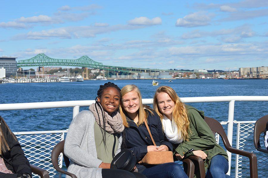 Junior+AP+Gov+students+Kiara+Breault%2C+Kalin+Gregoire%2C+and+Ally+Rose+relax+on+the+upper+deck+of+The+Rita+with+the+views+of+the+harbor+behind+them+and+Boston+before+them.