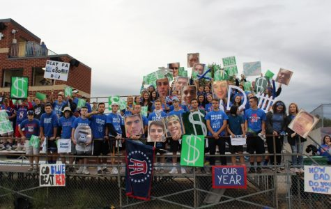 The Senior Gators gather before the Mack Plaque football game, loaded with numerous sings and fatheads.
