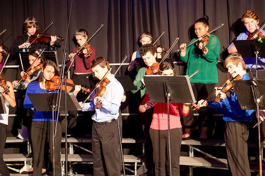 The orchestra performs a Lady Gaga hit mix, directed by Mr. Beaulieu at Prism last year.