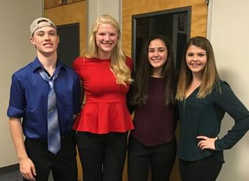 Hosh Posh Losh, an a cappella group created in honor of choir teacher Mrs. Loschiavo, performs at Prism this weekend.  Group members include sophomore Michael Crowley, junior Josie Collins, sophomore Abigail Palmer and founder of the group, junior Mary Sullivan.