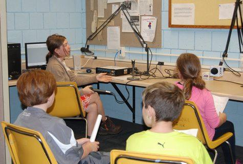 Fifth grade class records book promos for LEO 103