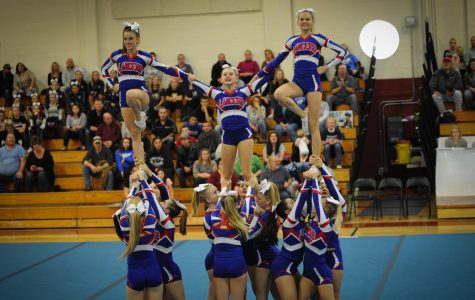 The varsity cheerleaders build a pyramid as part of the routine they perform at pep rallies.  This is one of the stunts they will perform at the States competition to take place this Sunday at Pinkerton.
