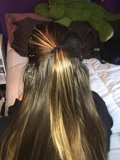 style-3_-step-2_-tie-back-the-top-half-of-te-hair-into-a-smooth-ponytail