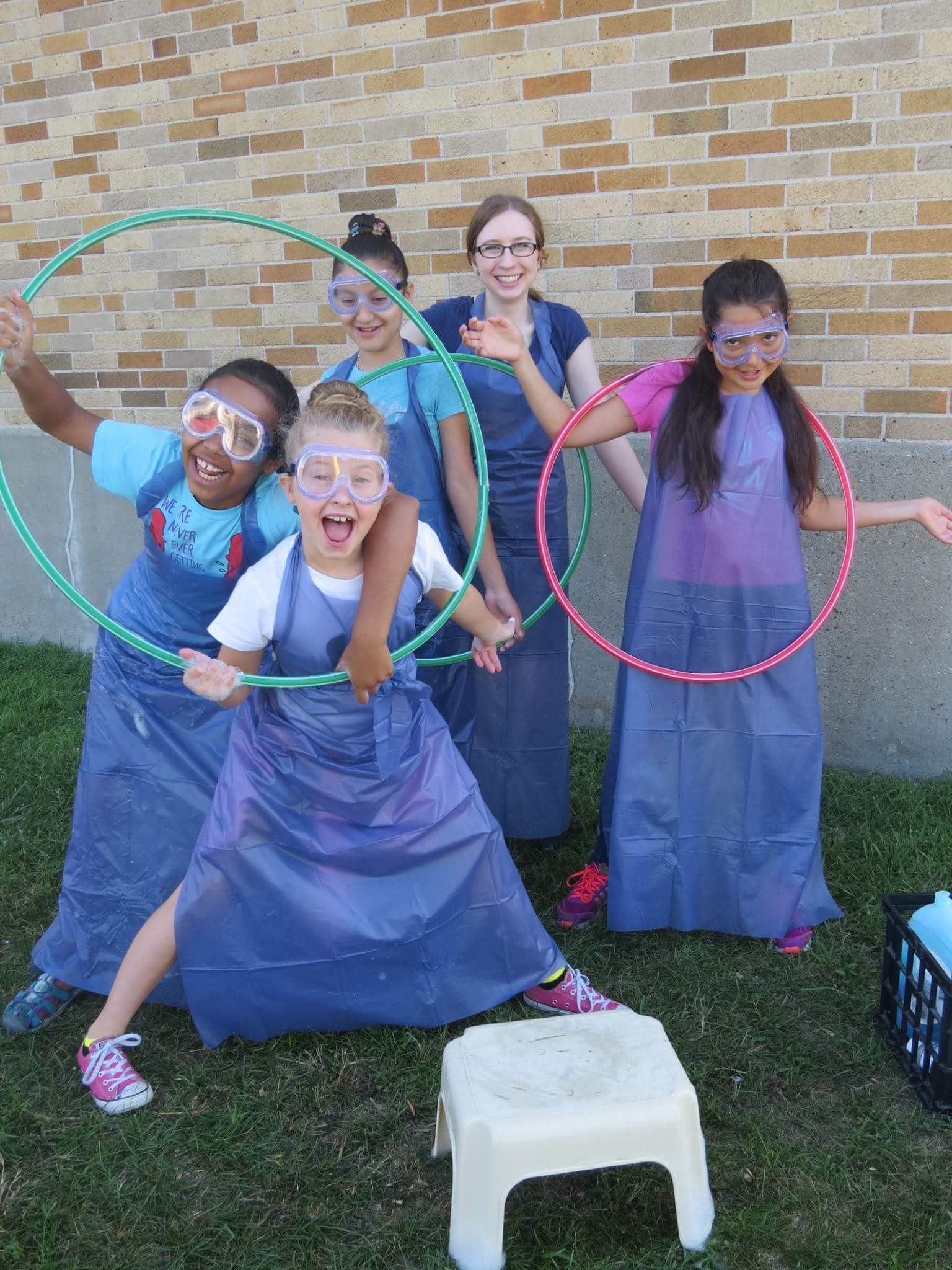 Erin McKenny (back row), works with some of her students from the Curiosity Science Program she created for her Girl Scout Gold Award project.