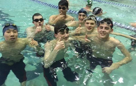 Swim teams see both success and improvement
