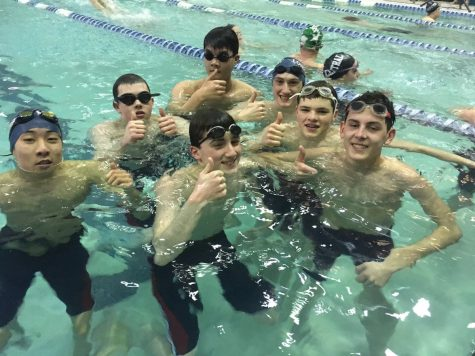Swim teams see both success and improvement