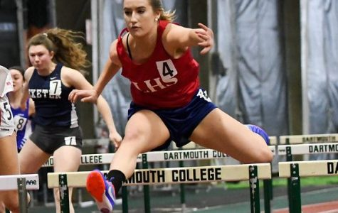 Freire strides for the finish line in her hurdles race. The  senior Lancer took home first and also was a part of the winning 4x200 m relay team.