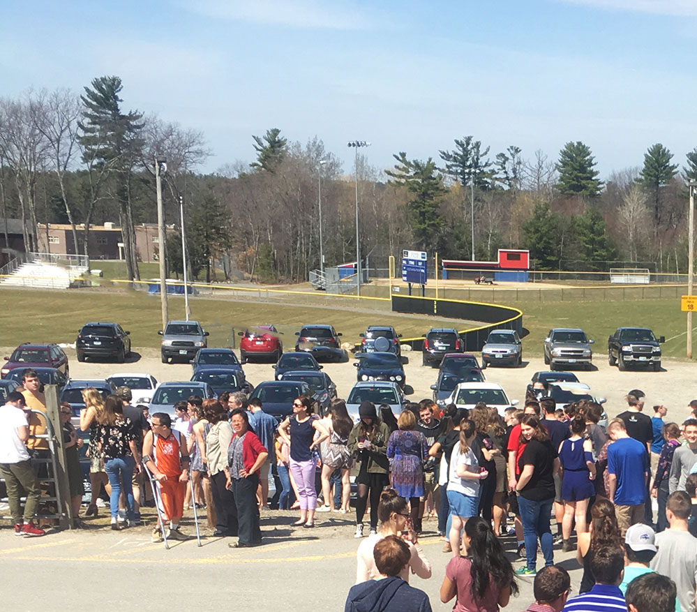 Students filing into the plateau parking lot during the most recent fire drill.