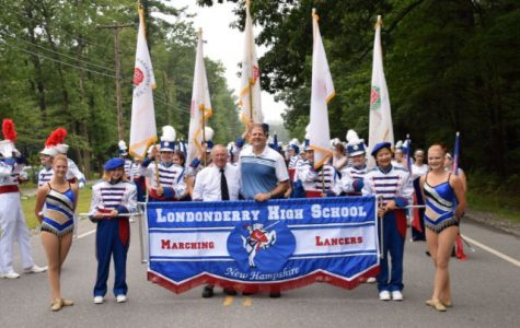 Morgan Torre (Left) and Emily Cowette (Right) lead the LHS marching band at the Old Homes parade on August 24th.