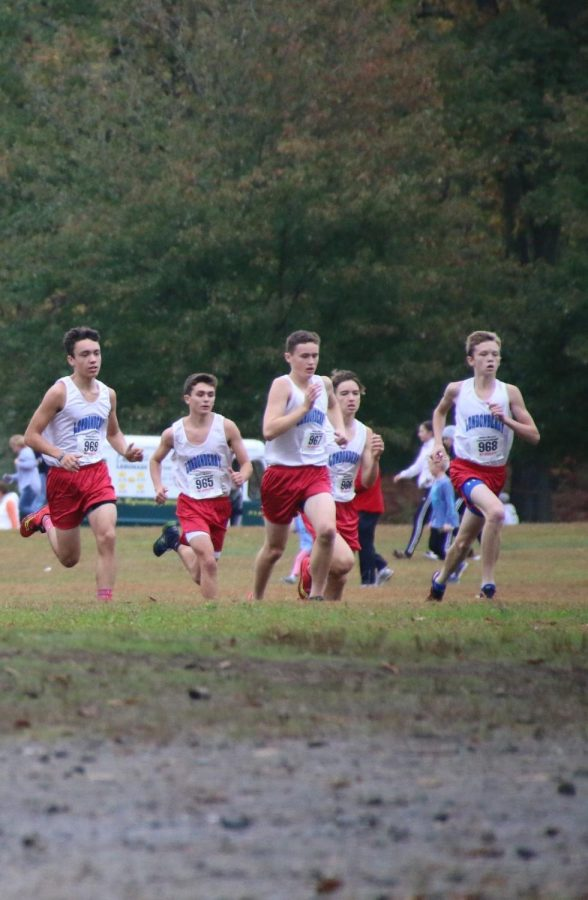 The cross country team boys running in the Brown Invitational last year.