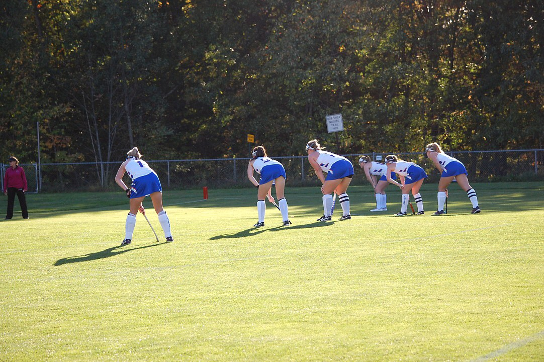 Varsity field hockey seniors line up for a corner.