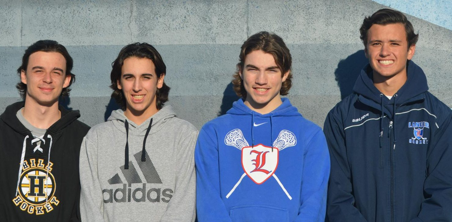 Varsity captains takes pre-season picture with their mullets on display.
