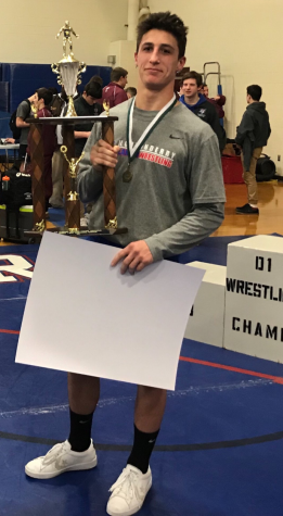 Senior wrestler comes in first place at NHIAA D1 championship