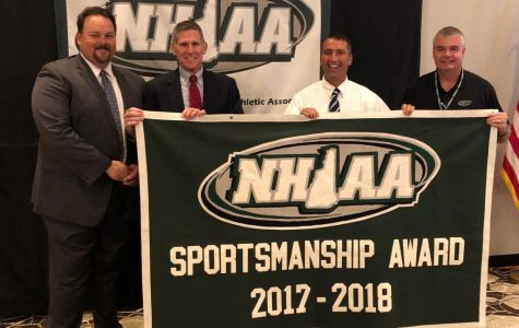 Mr. Parent and Mr. Sobolov accept the NHIAA award.