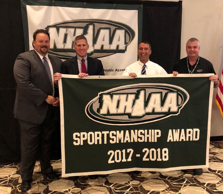 Mr. Parent and Mr. Sobolov accept the NHIAA award.