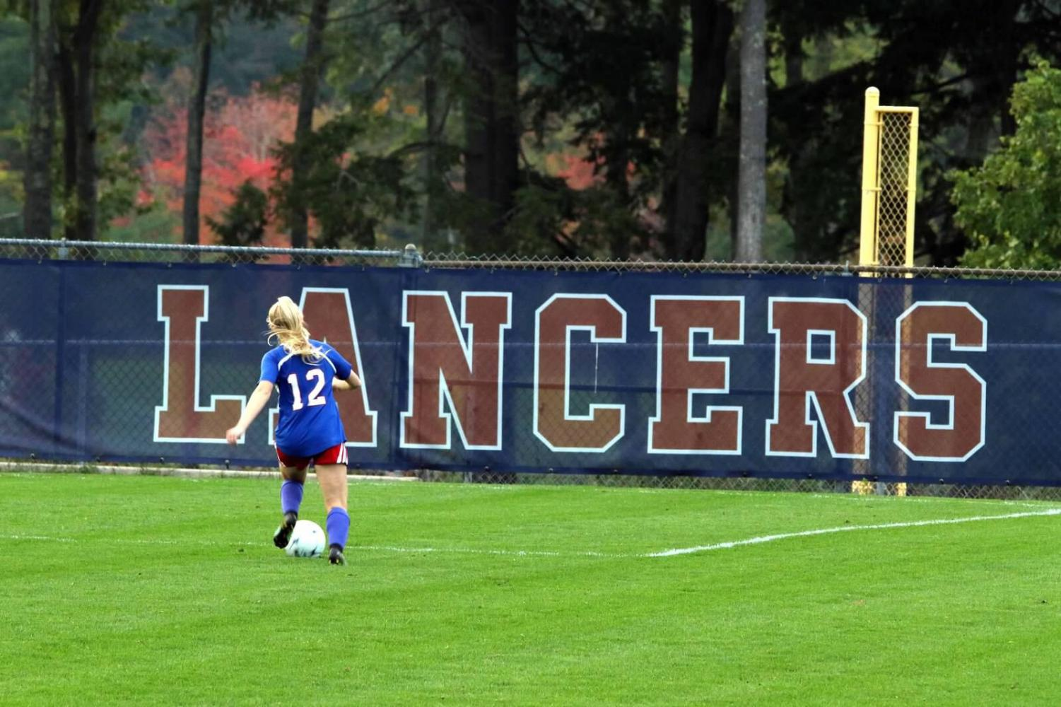 Junior Abbie Ellis plays a strong defensive game for the Lancers.
