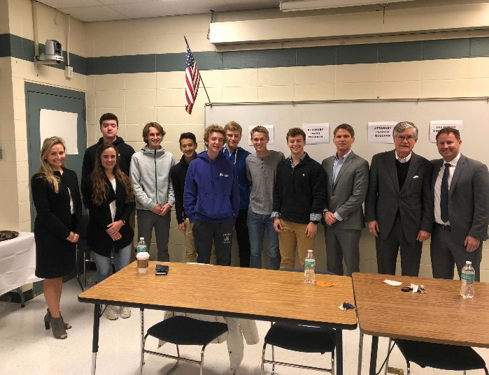 Ap Government students gather with the lawyers and former Supreme Court Justice of N.H. after participating in their discussion.