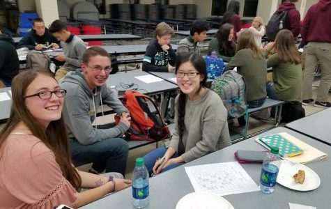 Math Team members Tim Gore and Katie Lacerda celebrate after home meet Wednesday, November 7.
