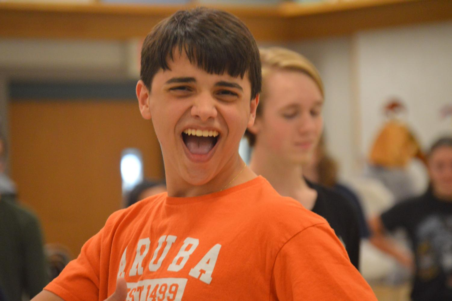 Junior Timothy Costello rehearses the dance from last year.