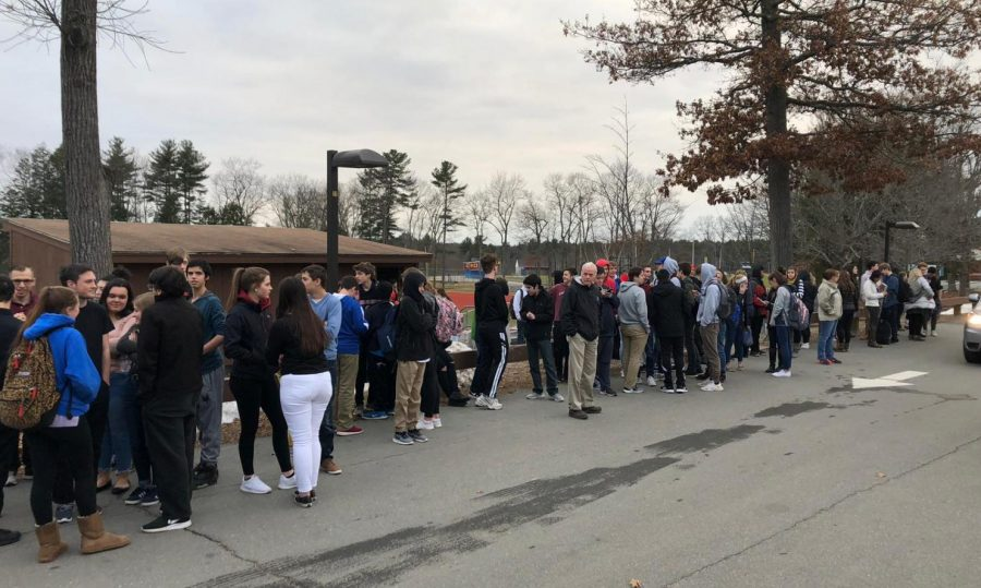 Students and faculty evacuate the building during Wednesdays false alarm.