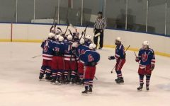 The Lancer squad celebrates in a team huddle after an exciting win.
