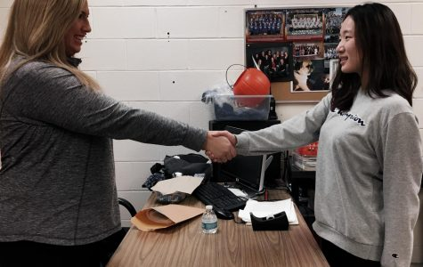 Mrs. Tebbetts (left) and Lauren Kim (right) shaking hands at the end of an interview.