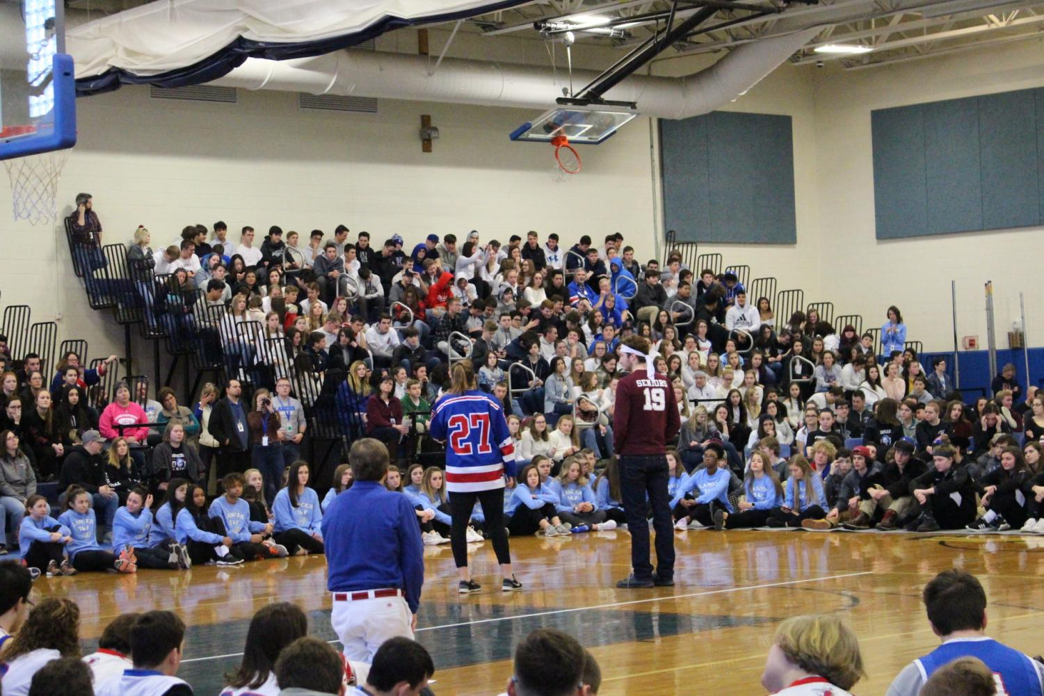 Student Council President Harry Feig and senior class President Liz Iaconis address Lancers during the winter 2019 pep rally.