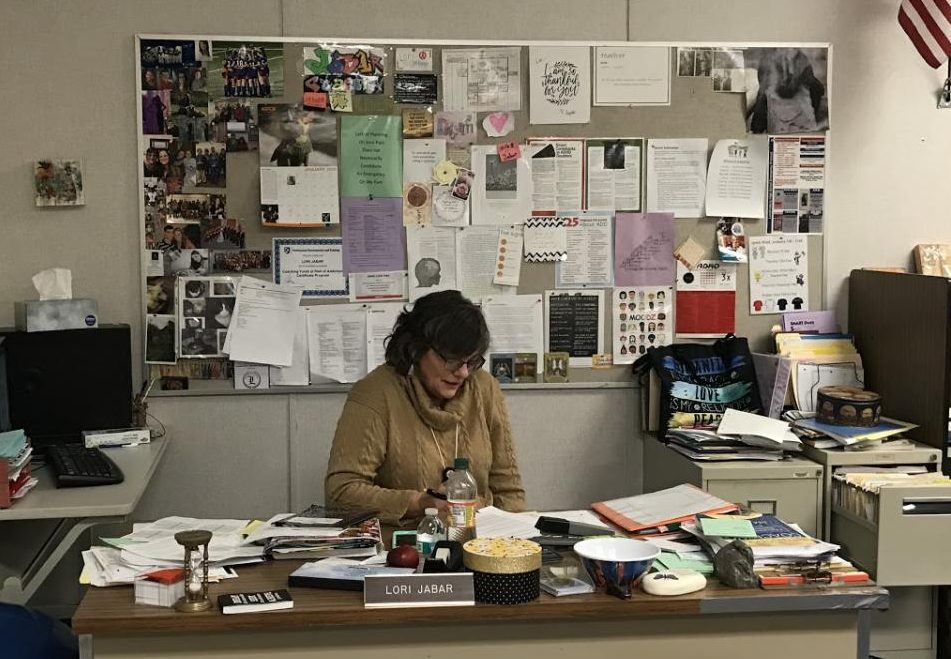 Jabar works tirelessly sorting through students tests and homeworks trying to help them organize. You can peek into her room anyday  and you will see her working hard.