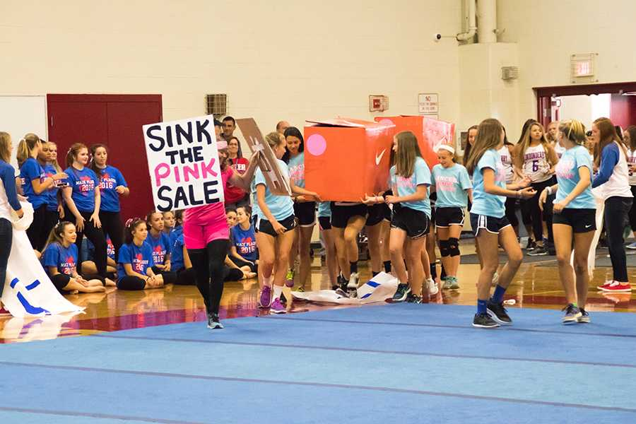 Girls' cross country takes the floor in a creative skit at the Mack Plaque pep rally in the fall of 2016.