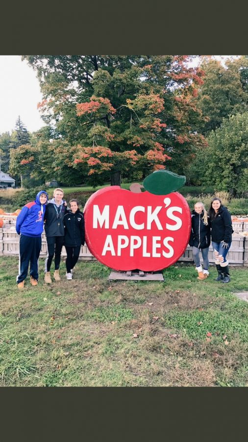 Students+from+the+class+of+2020+stand+next+to+the+Mack%E2%80%99s+Apples+sign+at+a+recent+class+event.+