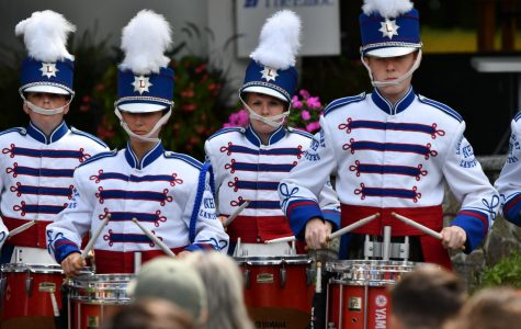 Gertz (second from the left) focuses intently on her performance at Old Home Days on August 8, 2018. The drum line also performs  at other evens such as parades, LHS football games, Celtics games and school pep rallies.