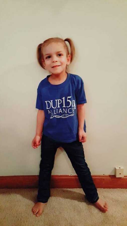 English teacher Ms. Murphy's daughter who is one of 1,300 cases, wears a Dup 15 shirt.