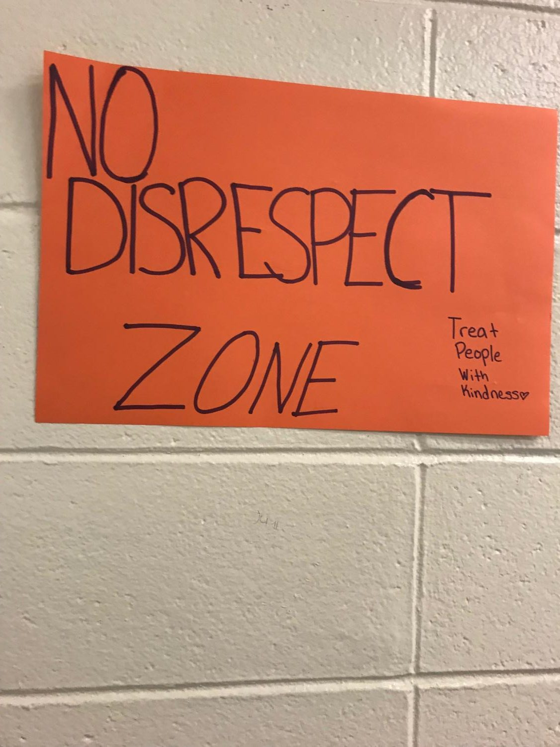Poster hangs on a wall in the school to spread the word about Granite State Respect Week.