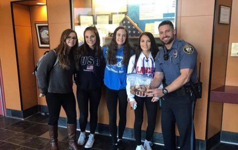 """Londonderry Lancer cheerleaders bring baked goods to the department to show gratitude and thankfulness to the officers. """"He was very excited to accept our cookies,"""" Sophomore cheerleader Megan Goodwin said. """"You could tell he genuinely appreciated the gesture."""""""