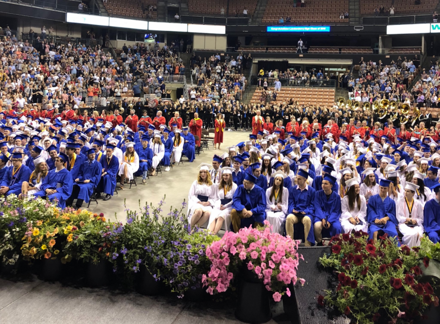 The+College+Board+plans+to+offer+scholarship+money+to+the+graduating+class+of+2020.+Pictured+here+is+the+LHS+graduating+class+of+2018.