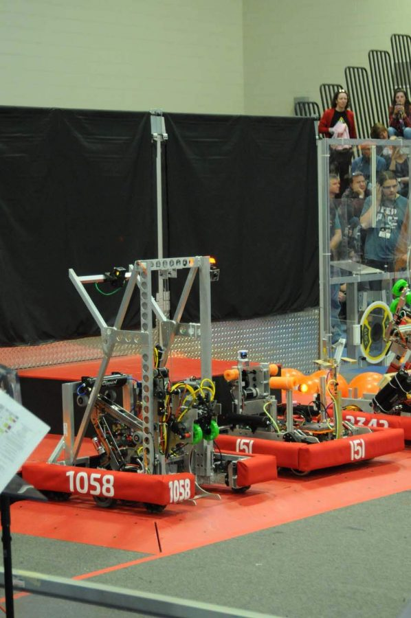 The+LHS+Robotics+team%27s+robot+%28number+1058%29+prepares+for+the+match+to+start.+Every+match+starts+with+the+%22sandstorm%22+period%2C+where+drivers+are+restricted+from+seeing+the+field+by+black+drapes.