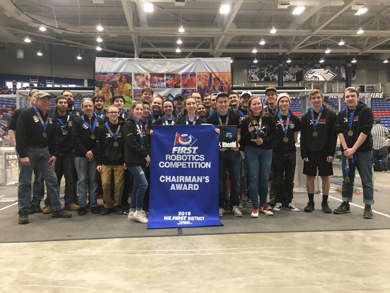 The robotics team poses with The Chairman's Award, after winning it at their last competition.
