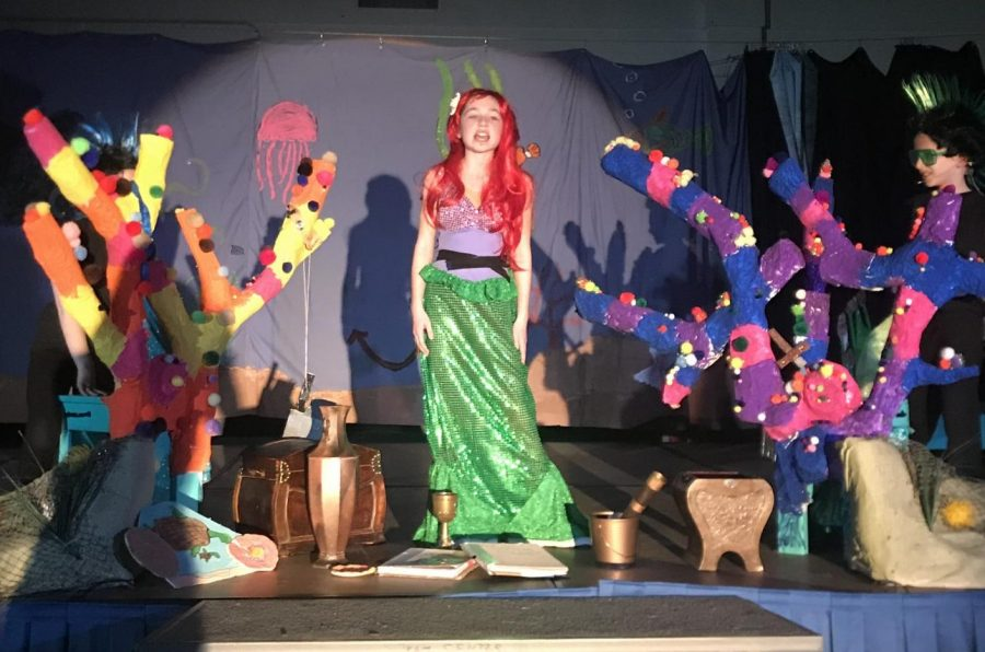 "Lead role Jillian Willwerth sings ""Part of Your World"" surrounded by props crafted by the Scenery Crew. The song is one of many Willwerth's voice is featured in."