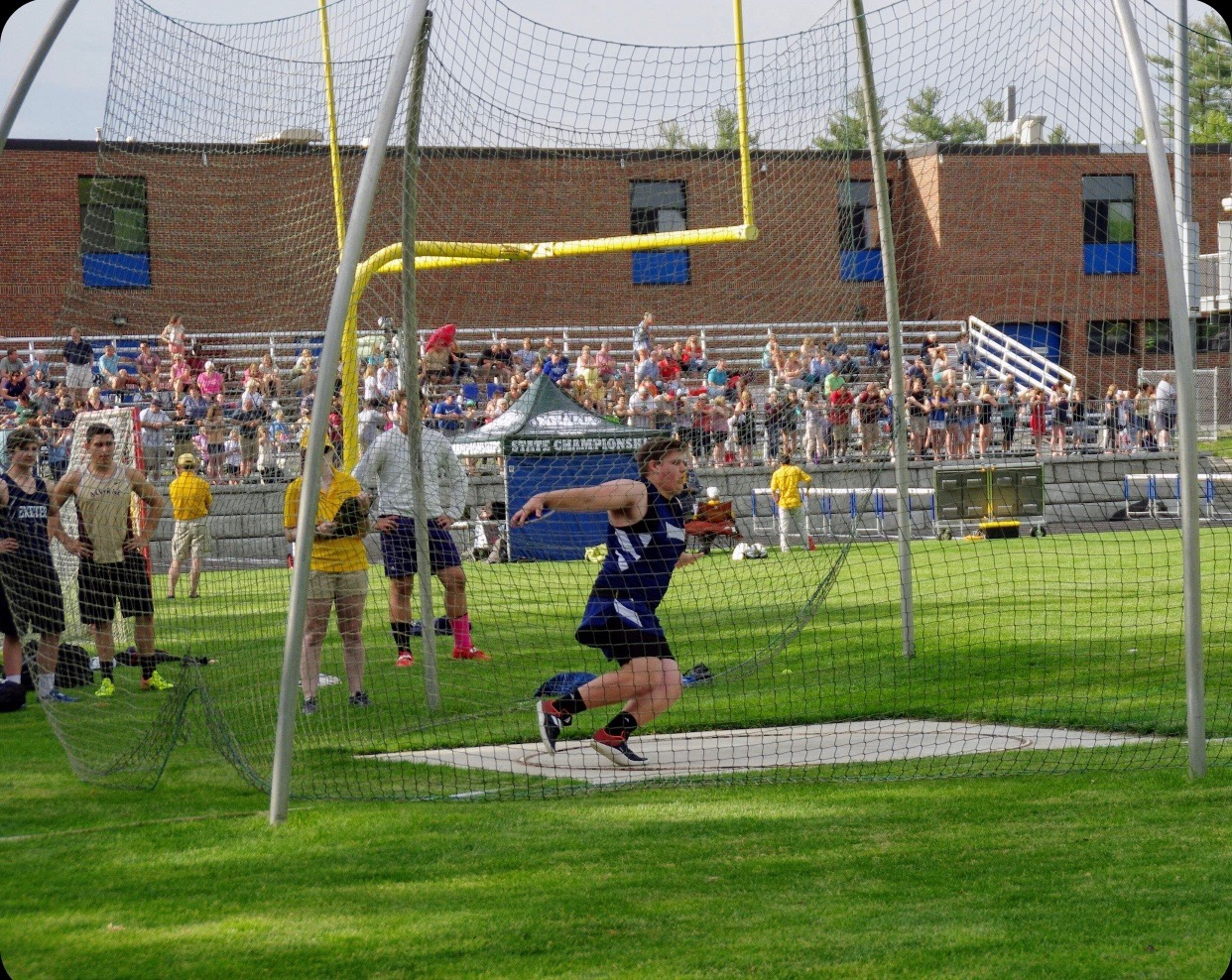 Hagearty winds up and prepares to hurl the discus down field.