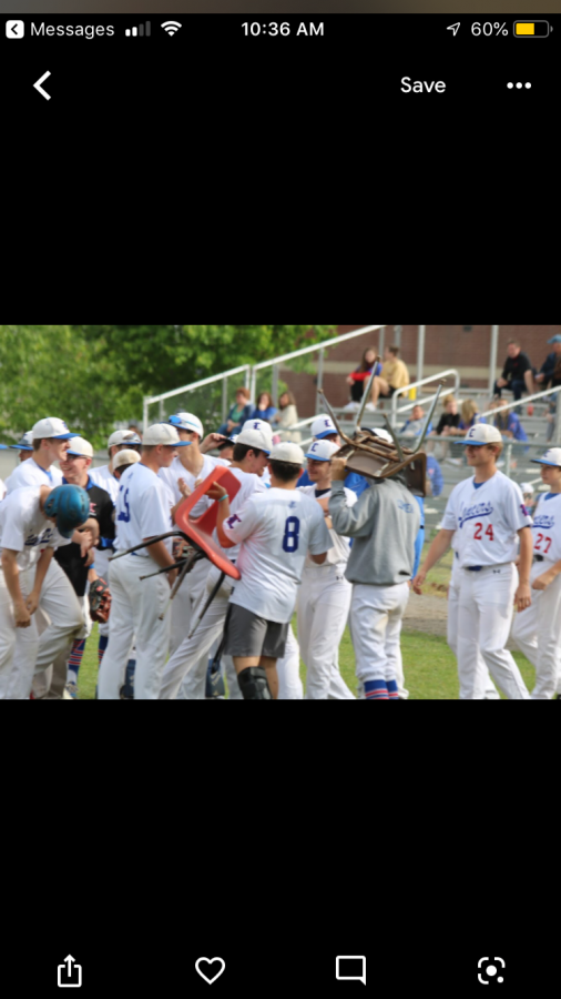 The team conversose after Junior Nolan Lincoln strikes out the side in their first playoff game vs. Spaulding.