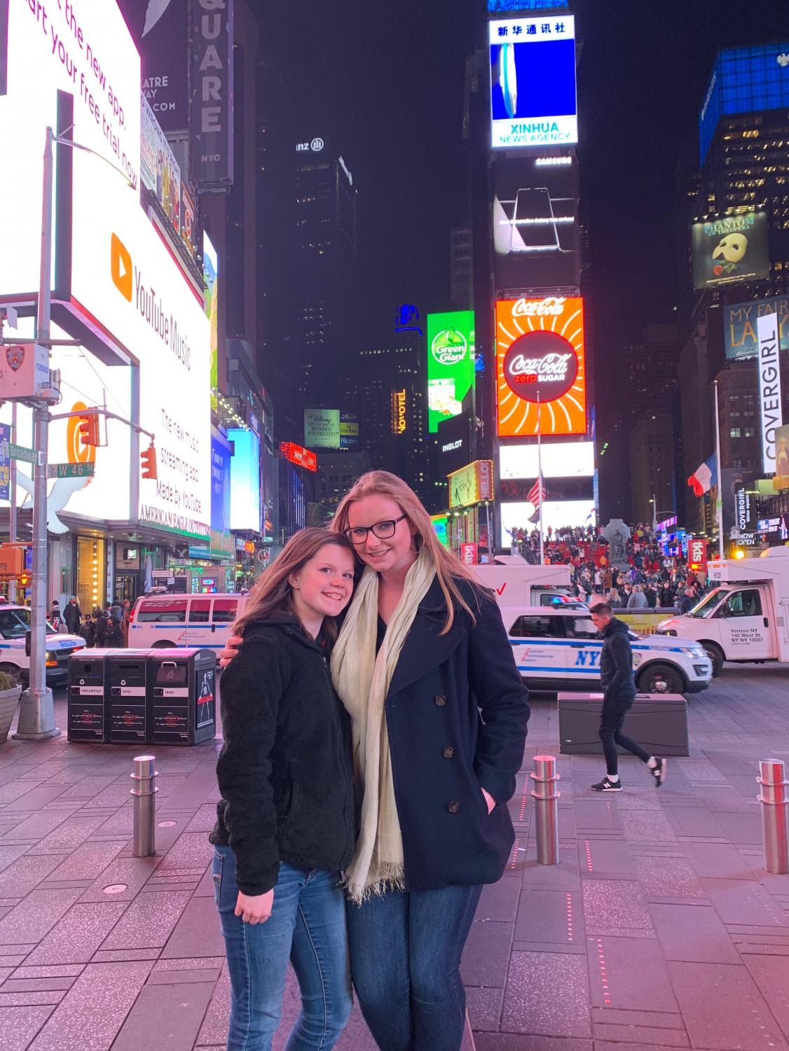 The two new yearbook chiefs pose in Times Square during a yearbook convention in New York.