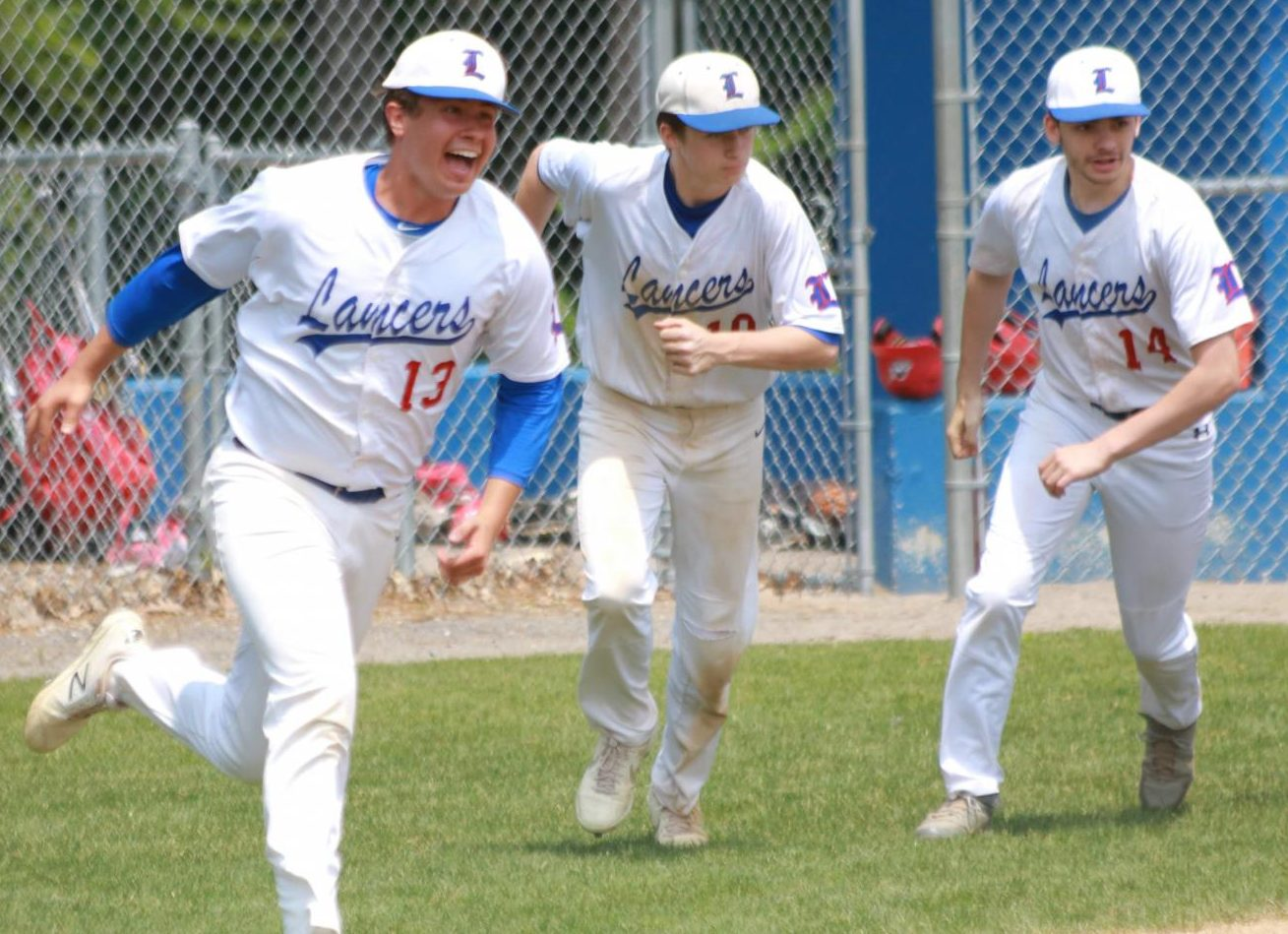 Manor celebrates with his teammates after getting the final out of the 4-1 victory vs. Pinkerton