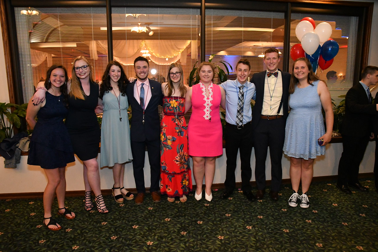 The new drum majors, colorguard captains and current drum majors pose for a photo after the highly anticipated announcement at the Lancer Music Banquet on May 30, 2019.