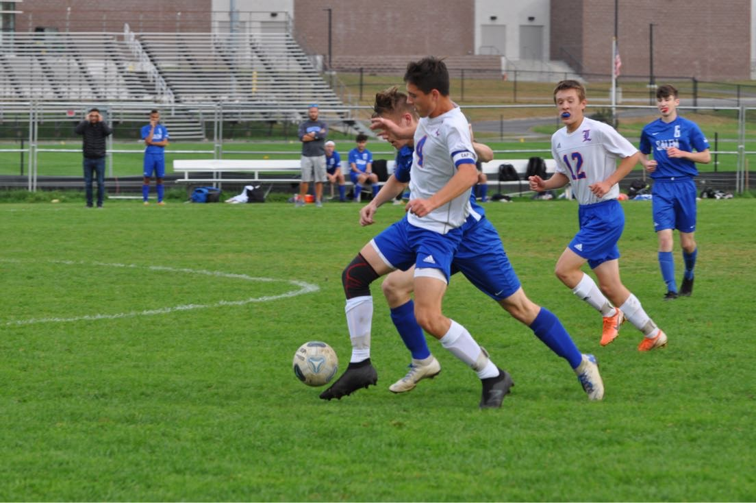 Keith Fletcher cuts off a Salem midfielder to regain control of the ball. The game resulted in a 2-2 tie.