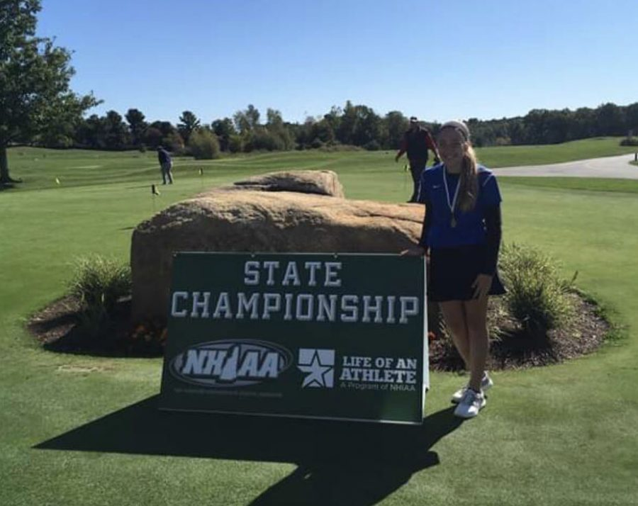 Riley+Anderson+poses+with+her+state+championship+medal+at+Campbell%E2%80%99s+Scottish+Highlands+Golf+Course+in+Salem%2C+New+Hampshire.+Anderson+shot+a+38+beating+her+nearest+opponent+by+six+strokes.%0A