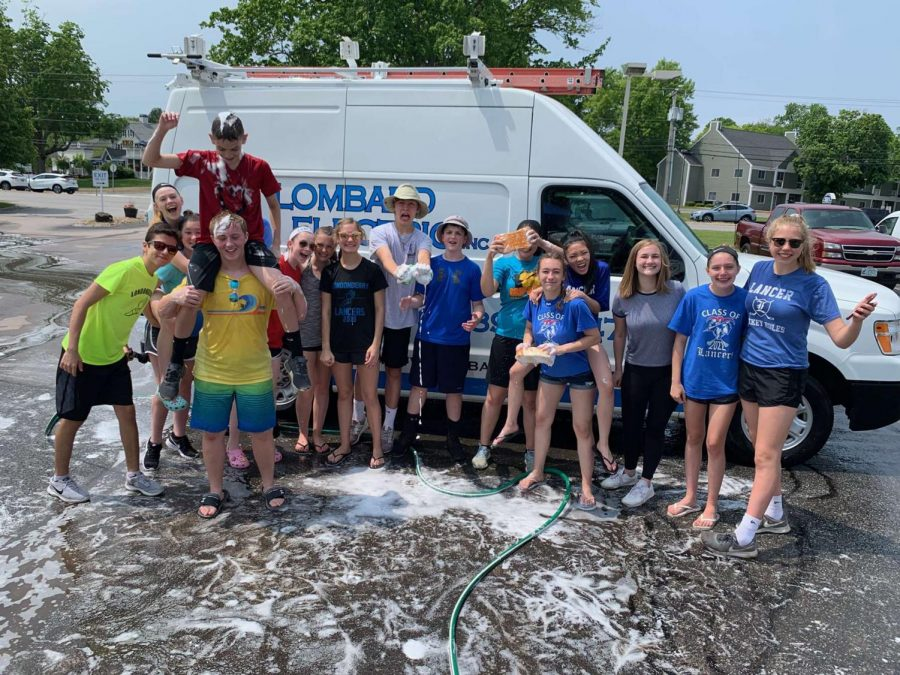The+Class+of+2023+Reps+take+a+photo+at+their+summer+fundraiser+car+wash.+