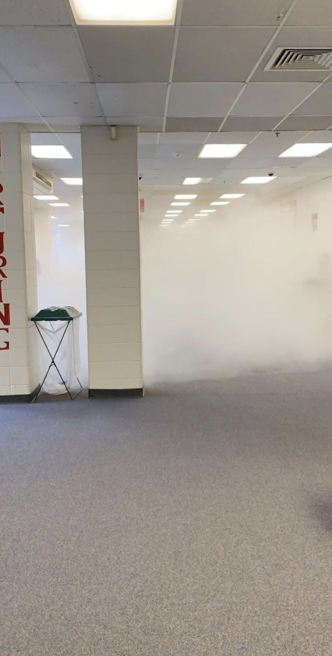 Students evacuated the school when a fire extinguisher accidentally fell and activated the main lobby.