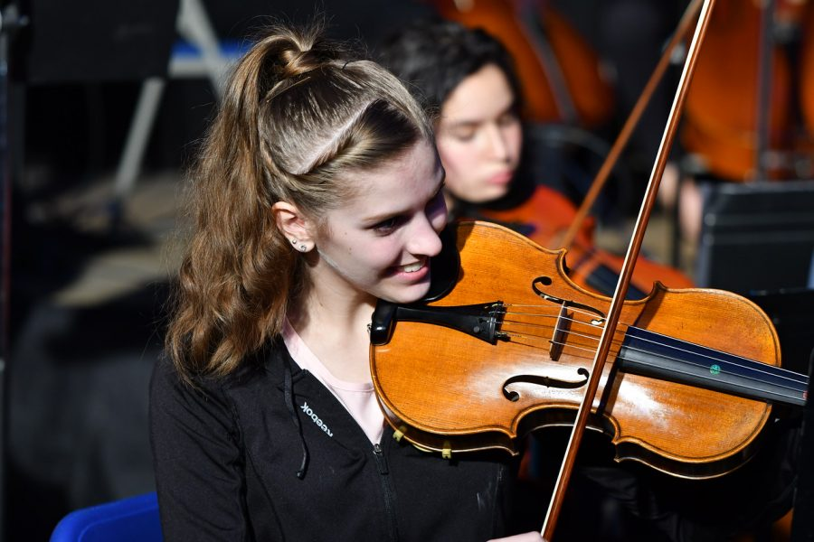 April+Mauceri+plays+the+violin+during+the+Prism+concert.